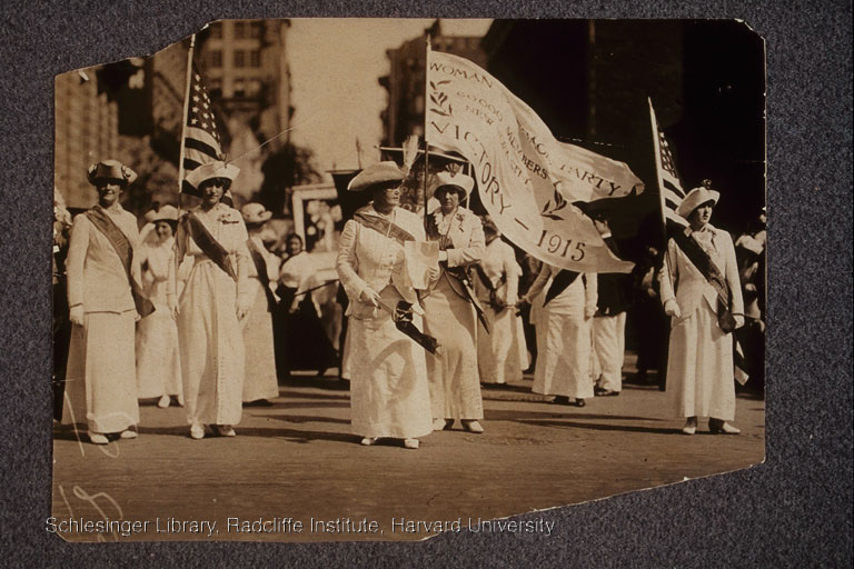 "Harriet Laidlaw and others in suffrage parade, headed by a woman carrying a banner: ""Woman Suffrage Party, 60,000 members, New York City, Victory - 1915""."