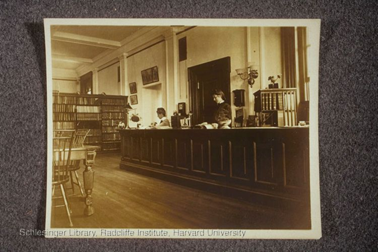 View of Campbell and another woman at the reference desk.