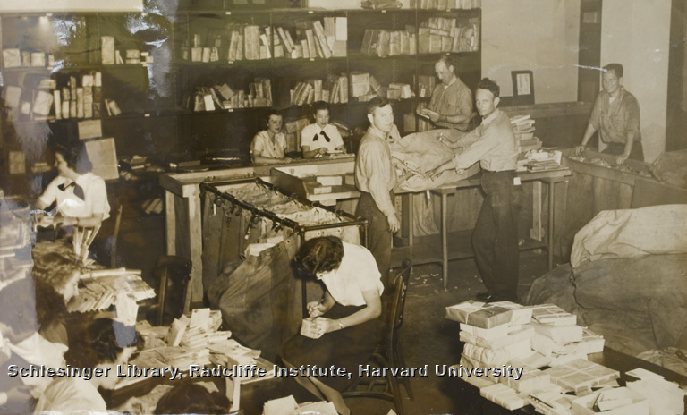 Women and men, members of the WAVES and Navy, at work in the mail room