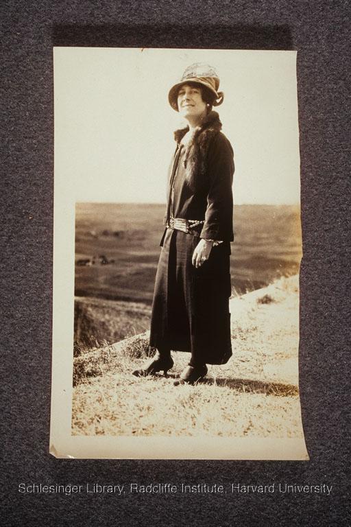 Grace Thompson Seton standing on a hill.
