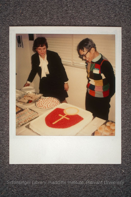 Pauli Murray looking at her post-ordination party cake, which is decorated with a woman's symbol.