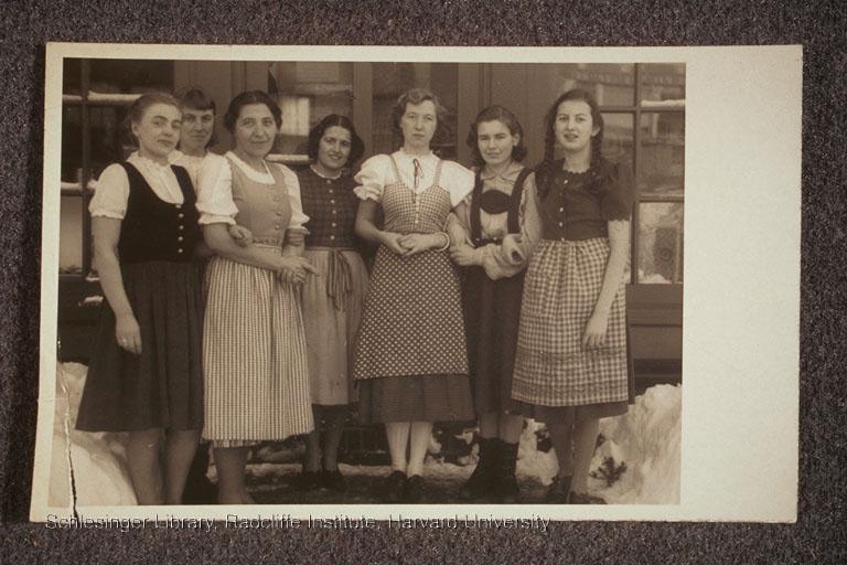 Seven women standing outside the Window Shop.