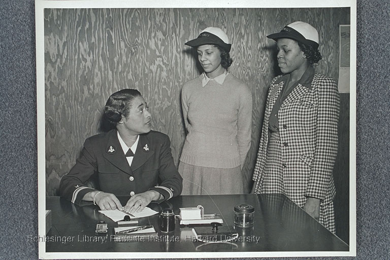 n African American WAVES officer talking with two African American women who are probably new recruits.