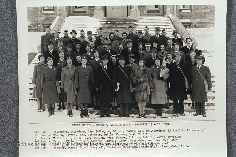 First graduating class of the protection course for civilian defense volunteers, held at Amherst College. Dorothy Dignam is standing third from left in the second row.