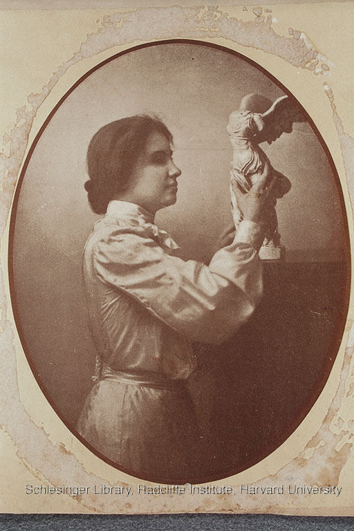 Helen Keller with a sculpture