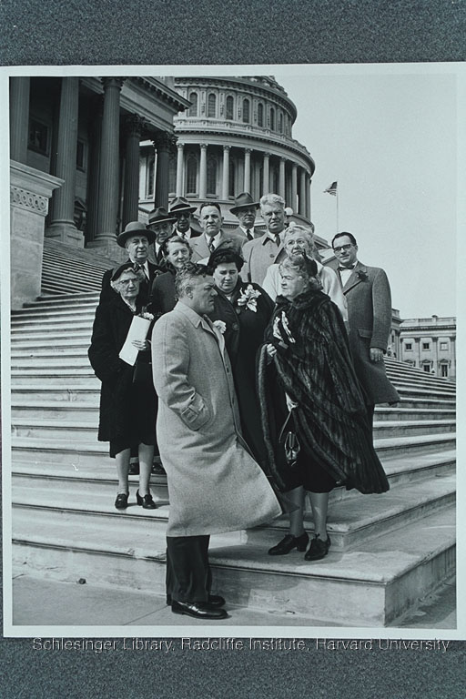 Edith Rogers talking with members of the American Legion on the steps of the United States Capitol