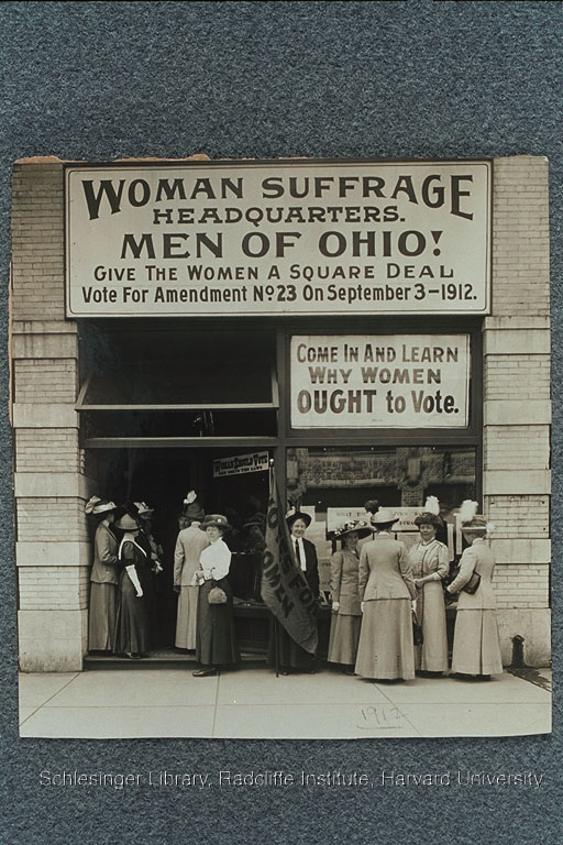 "Women standing outside the Woman Suffrage Headquarters of Ohio below a sign which reads: ""Men of Ohio! Give women a square deal Vote for Amendment No. 23 On September 3-1912."""