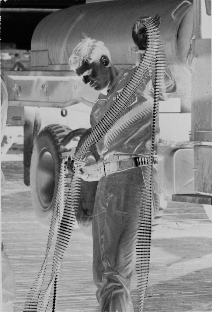 Untitled (Soldier Carrying Rounds Of Ammunition, Vietnam)