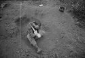 Untitled (Soldier Digging A Hole In The Dirt, Vietnam)