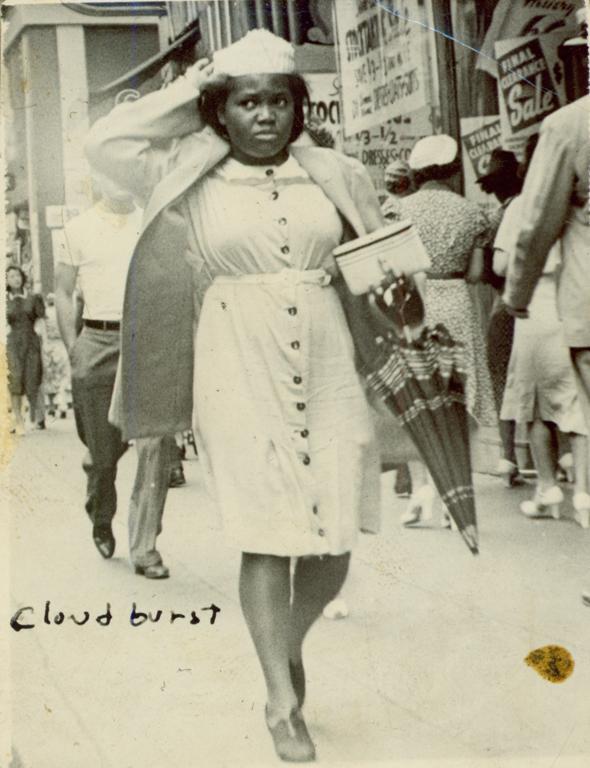 Ruth Batson walking down a city street