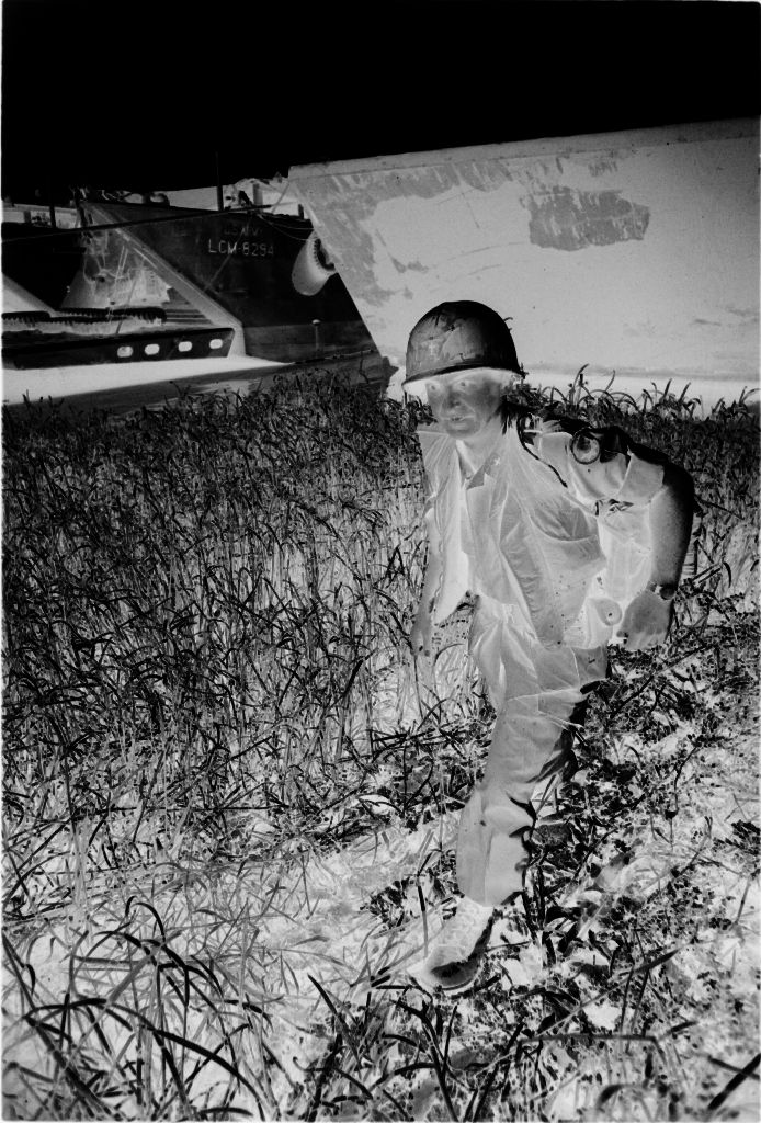 Untitled (Soldier Standing In Field With Ships In Background, Vietnam)