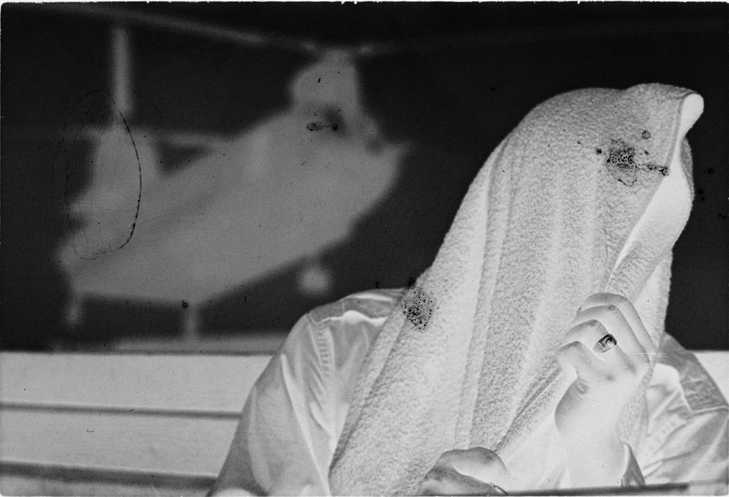 Untitled (Soldier Covering Head And Face With Towel, Vietnam)