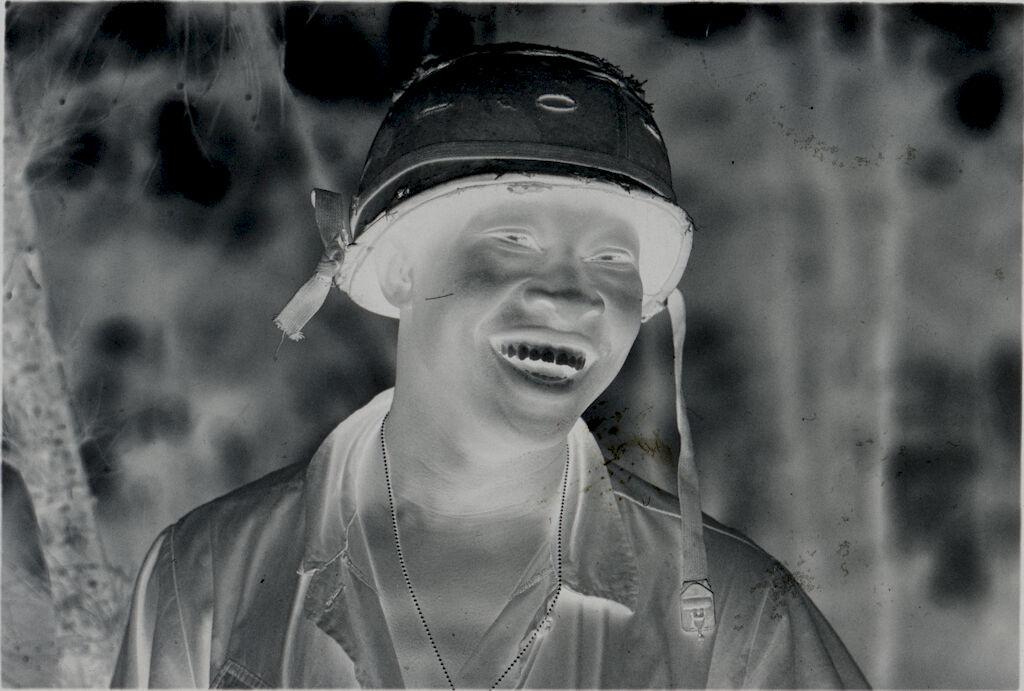 Untitled (Soldier In Helmet Laughing, Vietnam)