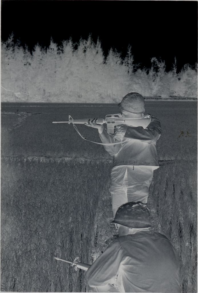 Untitled (Two Soldiers With Rifles In Rice Paddy, One Standing And Aiming, One Crouched, Vietnam