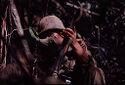 Untitled (Camouflaged Soldier Holding Gun During Fighting In Central Highlands Near Dak To, Vietnam)