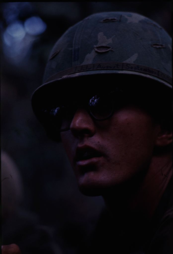 Untitled (Soldier In Camouflage Helmet And Sunglasses, Central Highlands Near Dak To, Vietnam)