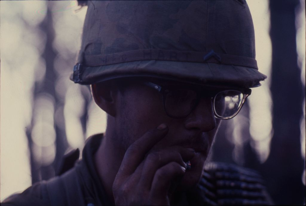 Untitled (Soldier In Helmet And Glasses Smoking Cigarette, Central Highlands Near Dak To, Vietnam)