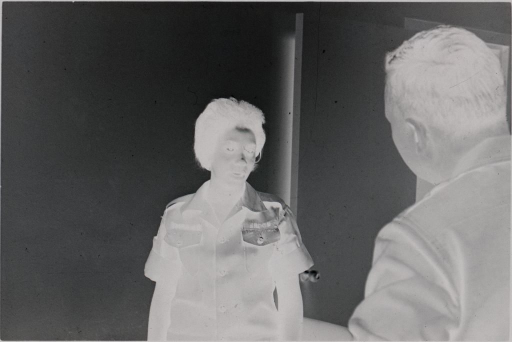 Untitled (Two Soldiers Talking In Office, Vietnam)