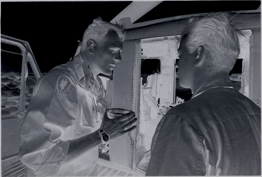 Untitled (Two Soliders Talking Outside Helicopter, Vietnam)