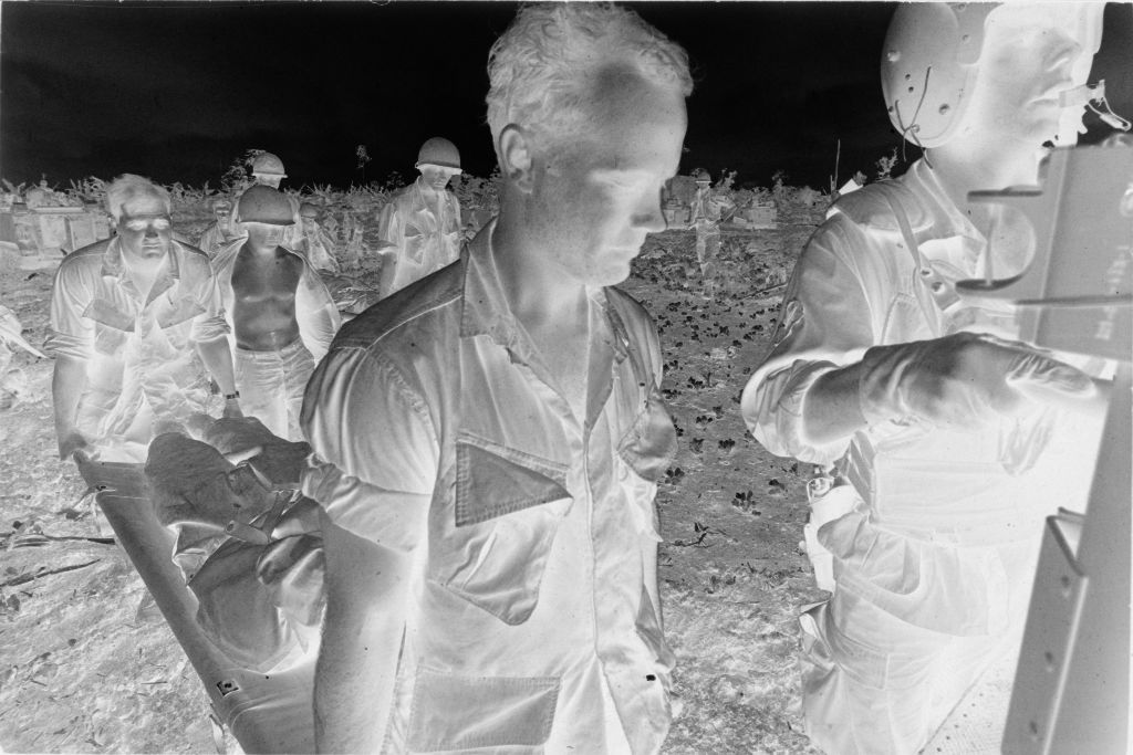 Untitled (Members Of 57Th Medical Division And 9Th Infantry Division Loading Wounded Soldiers Into Medevac Helicopter, Vietnam)
