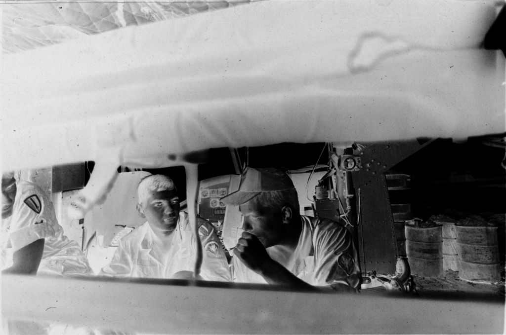 Untitled (Medevac Team Seated Inside Grounded Helicopter, Vietnam)