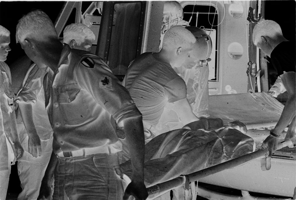 Untitled (Members Of 57Th Medical Detachment Unloading Stretcher From Medevac Helicopter, Vietnam)