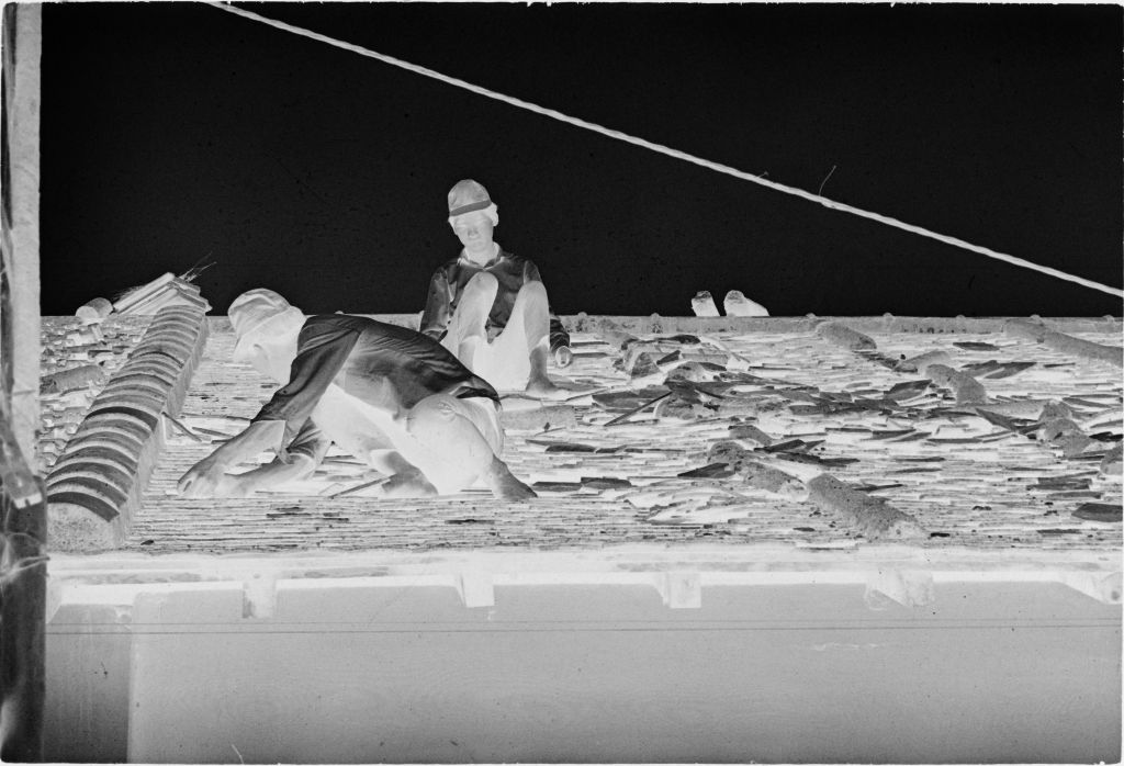 Untitled (Men Fixing Damaged Roof, Hue, Vietnam)