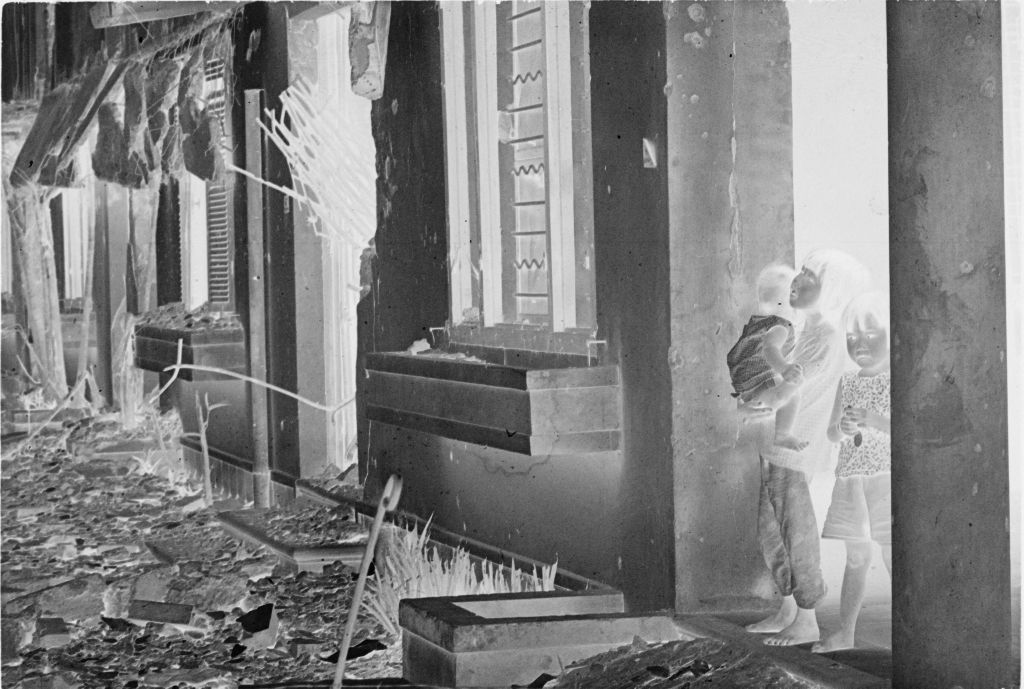 Untitled (Three Children Standing In A Doorway Of Damaged Building, Hue, Vietnam)