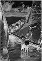 Untitled (Vietnamese Crossing Makeshift Span Of Partially Collapsed Bridge, Perfume River, Hue, Vietnam)