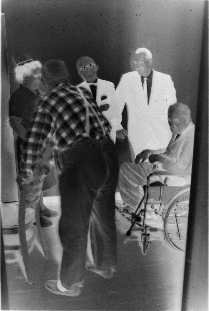 Untitled (Two Doctors, Nurse, And Two Patients Talking In Hallway)
