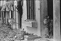 Untitled (Three Children Standing In A Doorway Of Damaged Building, Hue, Vietnam)