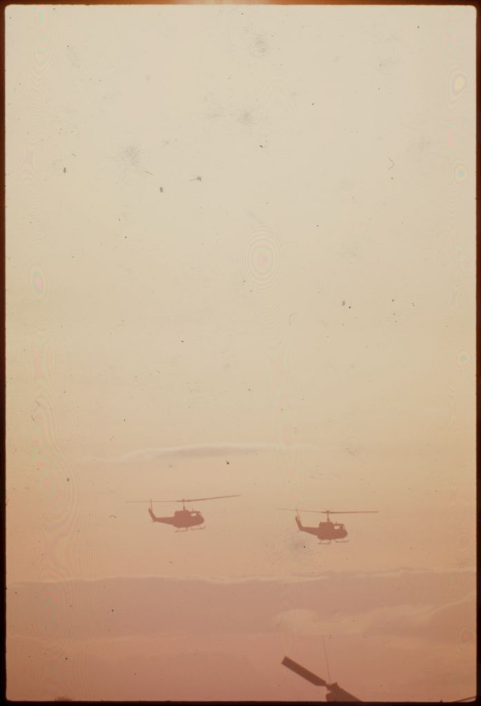 Untitled (Helicopters Flying Against Hazy Sunset, Vietnam)