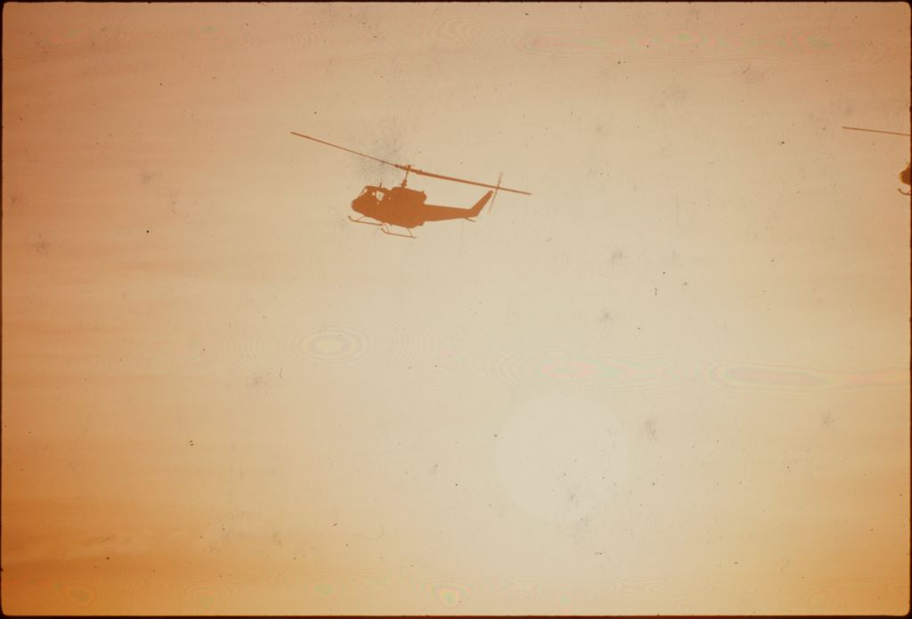 Untitled (Helicopter Flying Against Setting Sun, Vietnam)