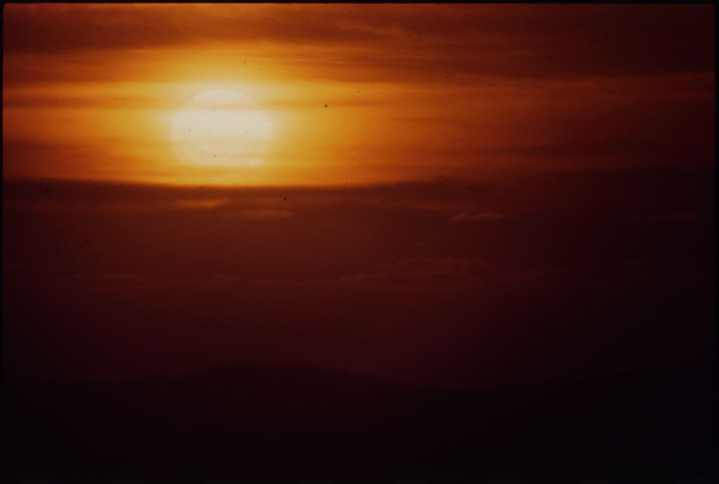 Untitled (Sun Setting Over Hills And Hazy Clouds, Vietnam)