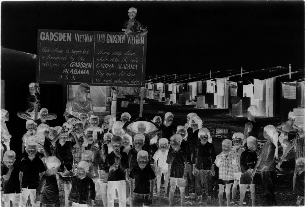 Untitled (U.s. Soldier And Group Of Vietnamese Children In Front Of Gadsden Town Sign, Vietnam)