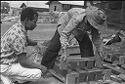 Untitled (Vietnamese Workers Constructing Wooden Crates(?), Vietnam)
