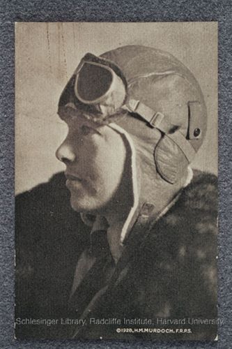Amelia Earhart in flight helmet and goggles.