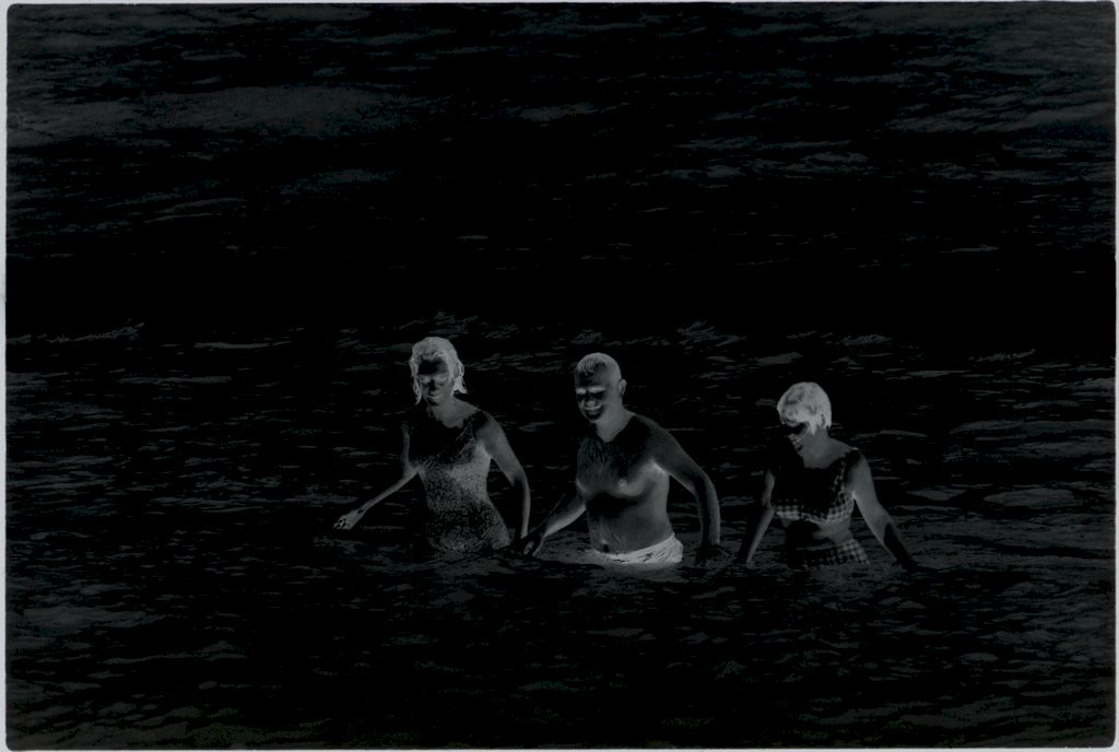 Untitled (Man And Two Women Coming Out Of The Ocean Holding Hands, Vietnam)
