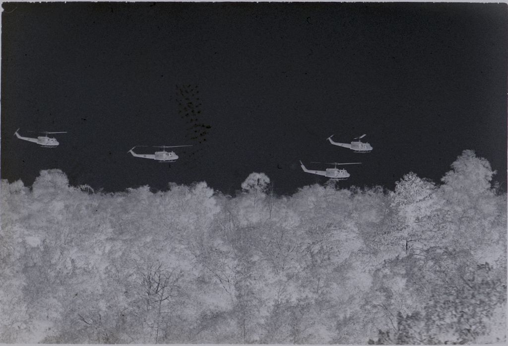 Untitled (Four Helicopters Flying Over Jungle, Vietnam)