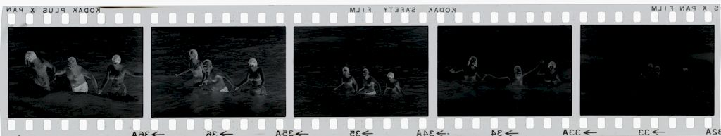Untitled (Man And Two Women In The Ocean, Vietnam)