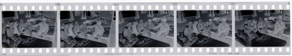 Untitled (Recovering Soldiers In Hospital Ward; Playing With Vietnamese Child, Vietnam)