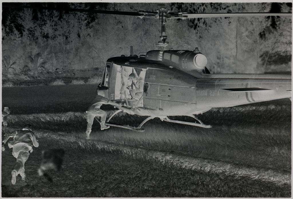 Untitled (Soldiers Guiding Landing Of Helicopter, Vietnam)