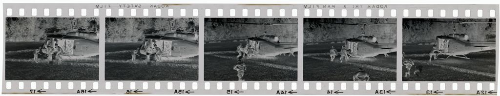 Untitled (Soldiers Directing Arrival Of Helicopter In Field; Unloading Supplies, Vietnam)