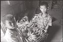 Untitled (Two Boys Lifting Bin Of Bananas, Vietnam)