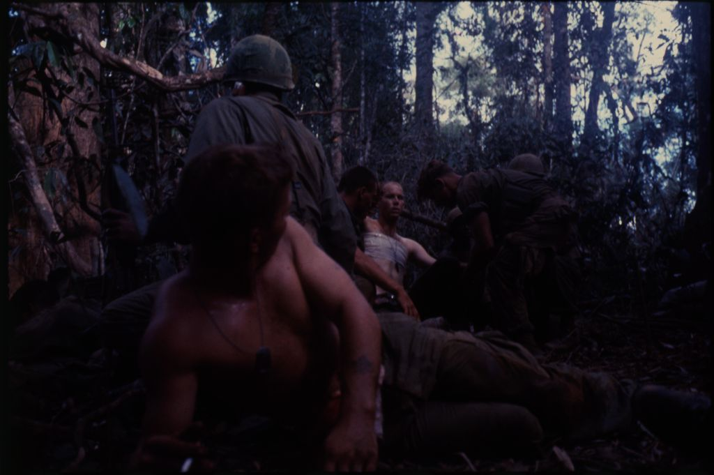 Untitled (Wounded Soldier Carried To Aid Station During Fighting In Central Highlands Near Dak To, Vietnam)