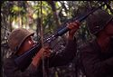 Untitled (Soldiers Aiming Guns Upward During Fighting In Central Highlands Near Dak To, Vietnam)
