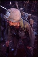 Untitled (soldier in combat gear hiking though jungle, central highlands near Dak To, Vietnam)