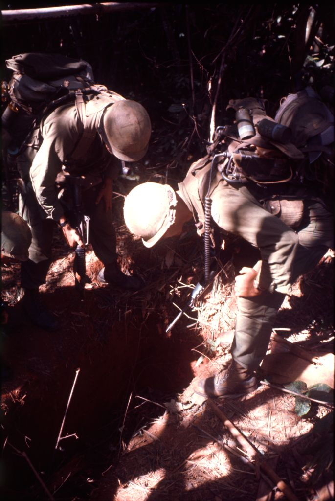 Untitled (Soldiers Examining Bunker Found In Jungle, Central Highlands Near Dak To, Vietnam)