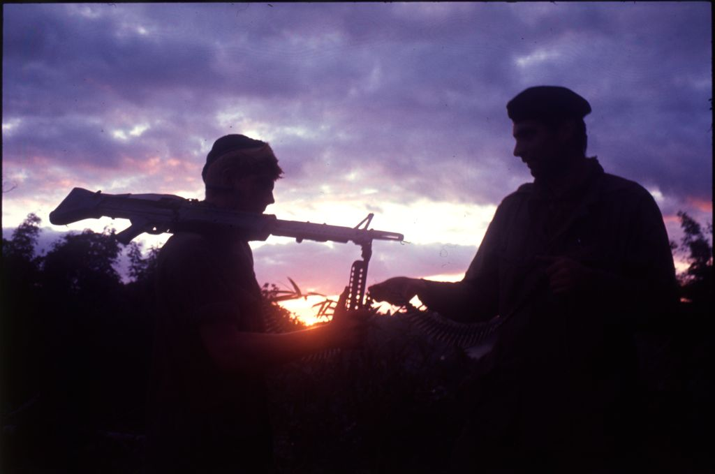 Untitled (Soldiers Silhouetted Against Setting Sun And Clouds, Vietnam)