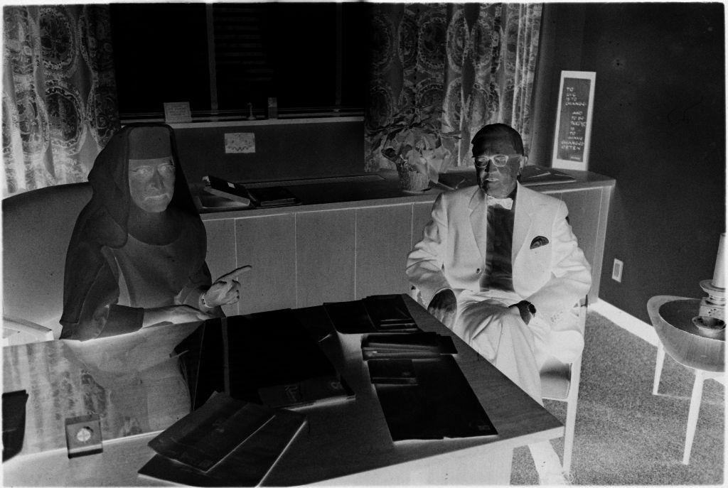 Untitled (Dr. Herman M. Juergens And Nurse Seated At Desk)